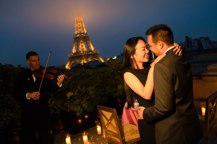 Romantic Paris proposal ideas with Classical Violinist on an exclusive rooftop of the Shangri-La Hotel with Eiffel Tower views