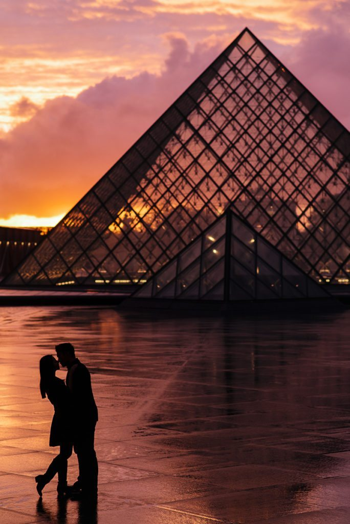 Paris engagement photos at the Louvre Museum during the rain