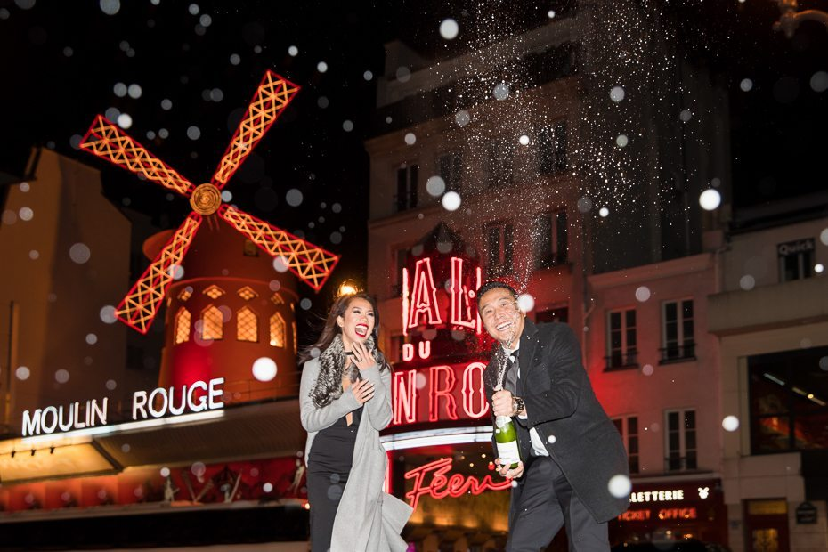Paris engagement photos with Champagne at Moulin Rouge